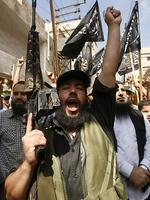 <p>An armed Palestinian Islamist shouts slogans in the Palestinian refugee camp of Ain el-Helweh near the southern Lebanese city of Sidon. Picture: AFP</p>