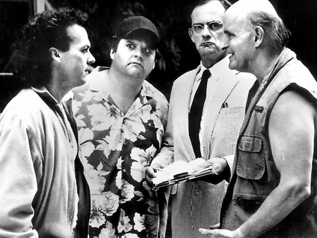 Michael Keaton with Stephen Furst, Christopher Lloyd and Peter Boyle in a scene from The Dream Team.