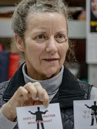 Karen Short holds the leaflets her husband was carrying with him during his trip to North