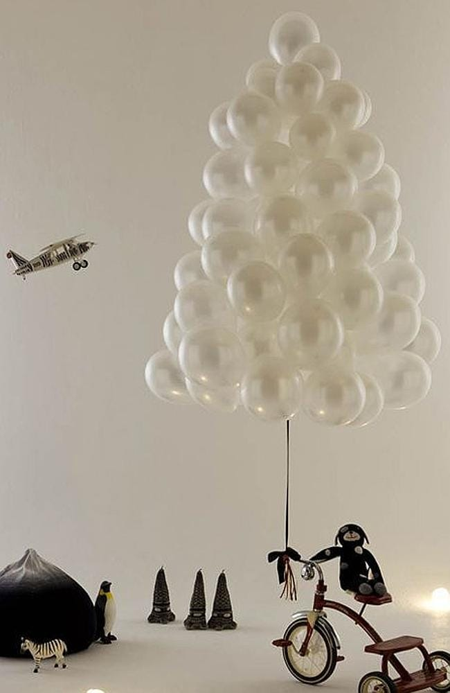 The cloud of balloons tree:  <b></b>not sure why there's a plane and a zebra though? Picture: Pinterest/Onemillionpicture.com