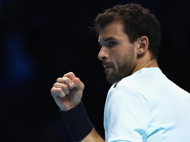 LONDON, ENGLAND - NOVEMBER 19:  Grigor Dimitrov of Bulgaria celebrates a break in the 3rd set during the singles final against David Goffin of Belgium during day eight of the 2017 Nitto ATP World Tour Finals at O2 Arena on November 19, 2017 in London, England.  (Photo by Clive Brunskill/Getty Images)