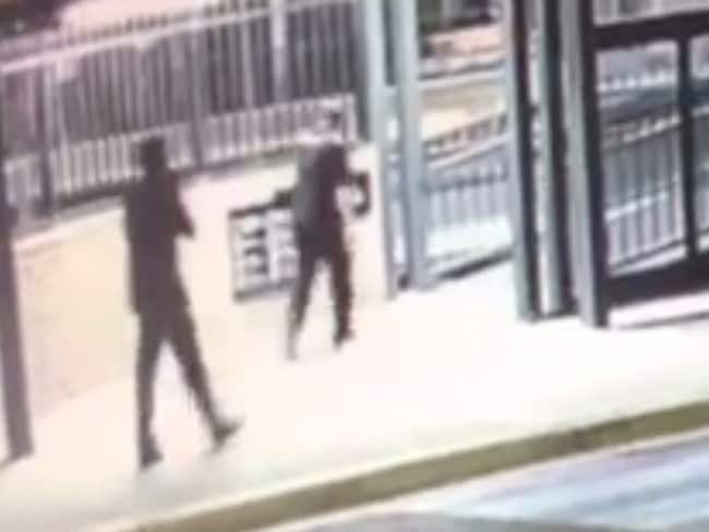 CCTV of the shot 21-year-old pizza shop worker running away injured.