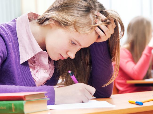 CAREERS: Student sitting at the classroom and working hard