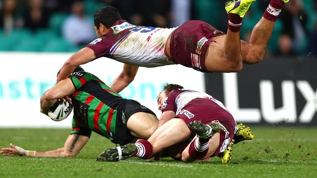 Brett Stewart puts a superb cover tackle on Greg Inglis. Pic: Renee McKay/Getty Images