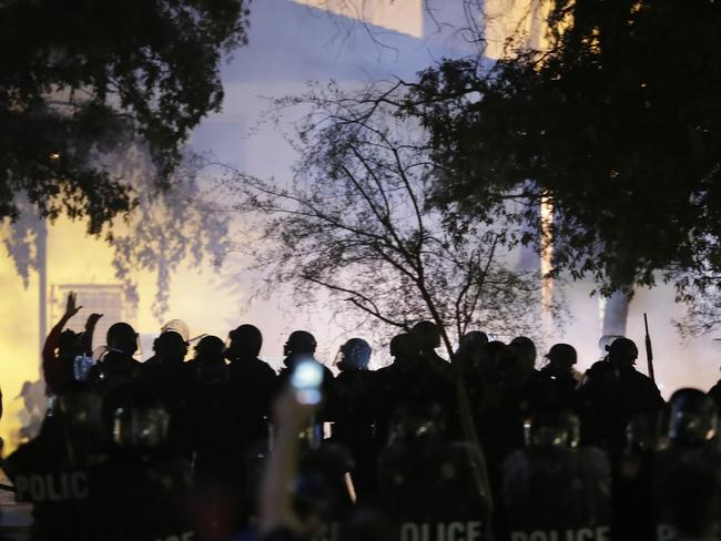 Phoenix police move protesters away after using tear gas outside the Convention Centre where Trump is speaking. The UN has issued a warning against Trump. Picture: AP Photo/Matt York.