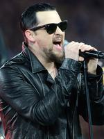 Joel Madden of the band the Madden Brothers performs before State of Origin III at Suncorp Stadium, Brisbane.