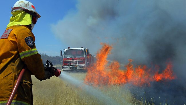 Firefighters at the fire near the Glen Esk Rd, Conara, in Tasmania. Picture: Chris Kidd