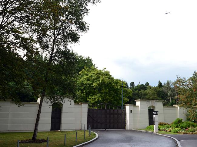 Police raid ... A gate leading into a private estate in Sunningdale, west of London, in which British pop singer Cliff Richard owns an apartment that was search by police on August 14, 2014. Source: AFP