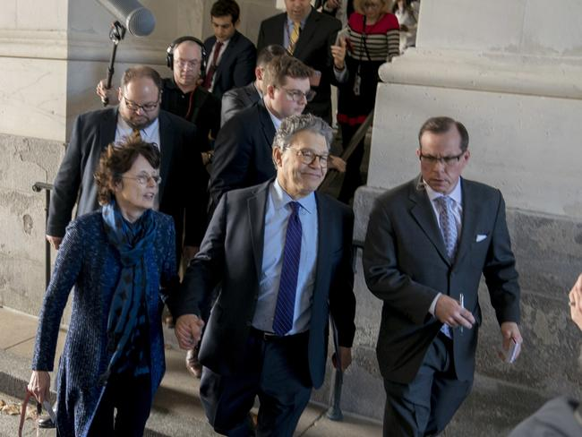 Sen. Al Franken holds hands with his wife Franni Bryson as he leaves the Capitol. Picture: AP