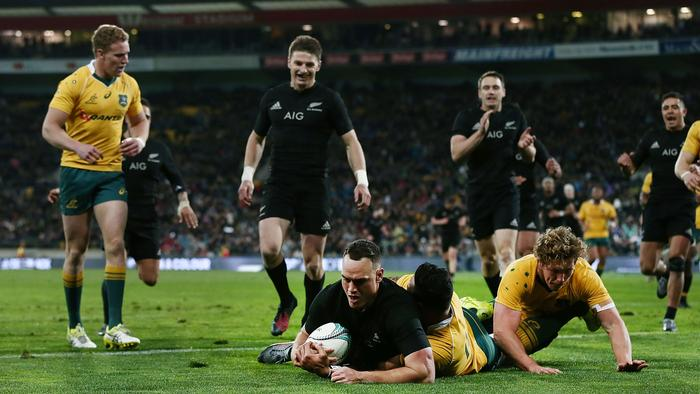 Israel Dagg of New Zealand scores a try against Israel Folau and Michael Hooper of Australia.