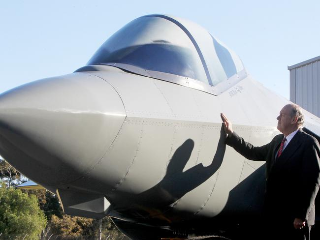 Defence Minister David Johnston unveils a life-size replica of the Joint Strike fighter plane at Edinburgh. Picture: Simon Cross