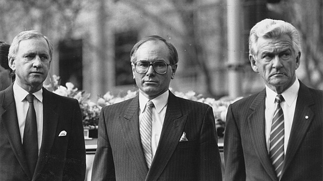 Then Prime Minister John Howard, centre, with Andrew Peacock and Bob Hawke.