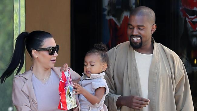 Could Kanye just be (gasp) happy? Picture: Clint Brewer/Splash News