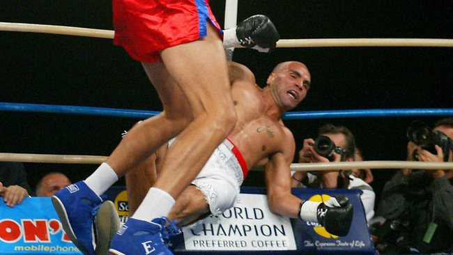 Part boxer, part gymnast, Mundine falls ever so gracefully like the true athlete he is. Picture: Phil Hillyard