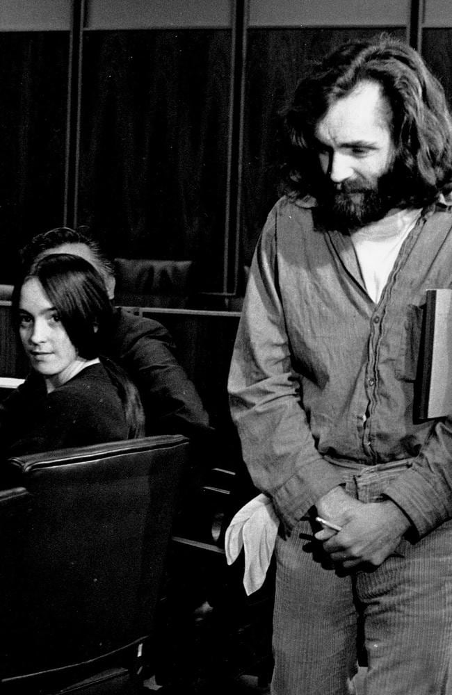 Cult leader Charles Manson walks into the courtroom as Susan Atkins, a member of his family of followers, looks on in Santa Monica, Calififornia, 1970. Picture: AP