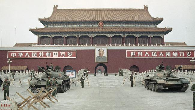 Back then ... Peoples Liberation Army (PLA) troops standing guard with tanks in front of Tiananmen Gate in 1989.