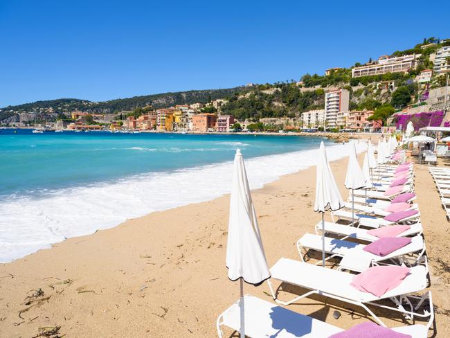 Beach with white sun beds and parasols on the French Mediterranean coast, the Cote d'Azur, south of France. Picture: Supplied