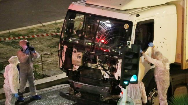 Authorities investigate a truck after it plowed through Bastille Day revelers in the French resort city of Nice. (Sasha Goldsmith via AP)