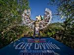 <p>Cliff diver, Jorge Ferzuli of Mexico, stands on the 27.25 metre diving platform dressed as a traditional Mayan eagle warrior.</p>  <p>Picture: Dean Treml / Red Bull Cliff Diving</p>
