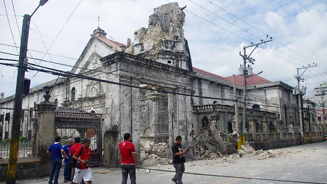 The Philippines' oldest church, Cebu's Basilica Minore del Santo Nino, was badly damaged, with its limsetone belfry in ruins.