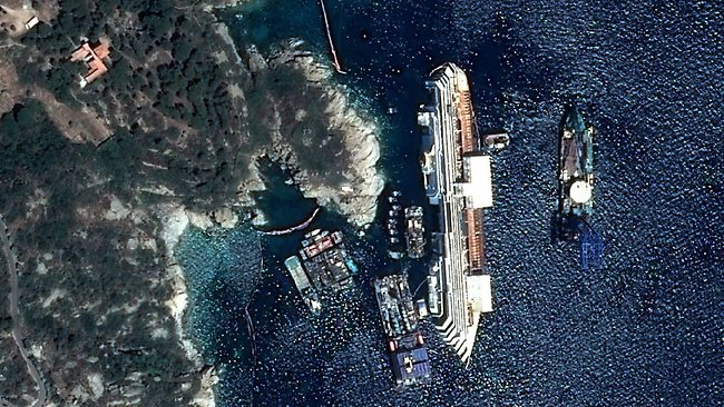 18/09/2013 WIRE: This photo provided by Astrium Tuesday, Sept.17, 2013 shows the capsized Costa Concordia on July 12, 2013. Engineers declared success on Tuesday, Sept.17, 2013 as the Costa Concordia cruise ship was pulled completely upright during an unprecedented 19-hour operation to wrench it from its side where it capsized last year off Tuscany. (AP Photo/CNES/Distribution Astrium Services/Spot Image)