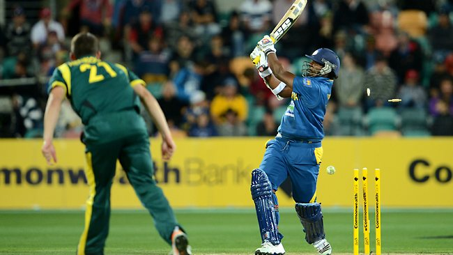 Sri Lanka's Thisara Perera is clean bowled by Moises Henriques. Picture: Dan Himbrechts