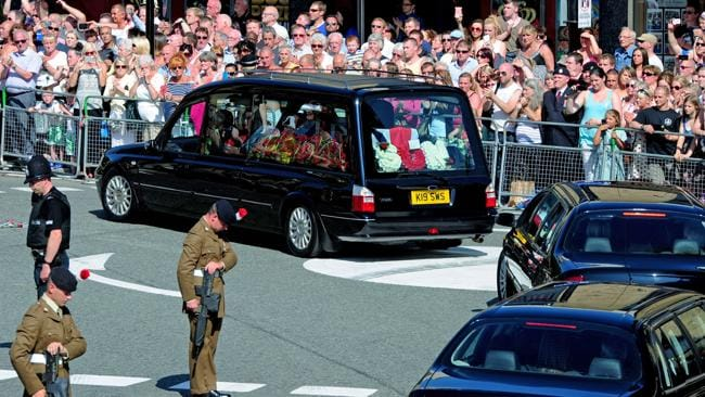A hearse carrying the coffin of Lee Rigby arrives at Bury Parish Church for a vigil in Bury, England. Picture: Getty Images