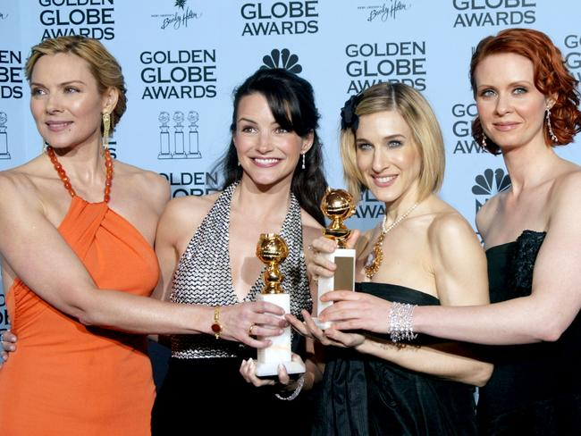 Iconic role ... Kim Cattrall, Kristin Davis, Sarah Jessica Parker and Cynthia Nixon pose backstage during the 59th Annual Golden Globe Awards in 2002. Picture: Getty