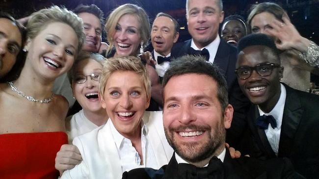 Spot the difference ... the original Oscars selfie shows actors front row from left, Jared Leto, Jennifer Lawrence, Meryl Streep, Ellen DeGeneres, Bradley Cooper, Peter Nyong'o Jr, and, second row, from left, Channing Tatum, Julia Roberts, Kevin Spacey, Brad Pitt, Lupita Nyong'o and Angelina Jolie. Picture: AP