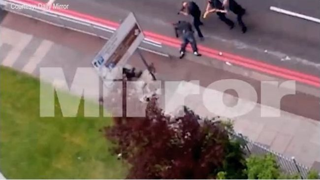 Police marksmen move in on one of the Wolwich atatck suspects after shooting him in the street follwoing the barbaric murder of soldier Lee Rigby. Picture: courtesy The Mirror