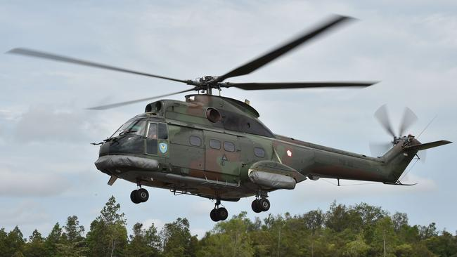 An Indonesian air force Puma helicopter takes off during search and rescue operations. Picture: Bay Ismoyo