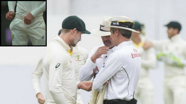 Umpires confront Cameron Bancroft over his use of a sticking plaster (inset) to ball tamper.