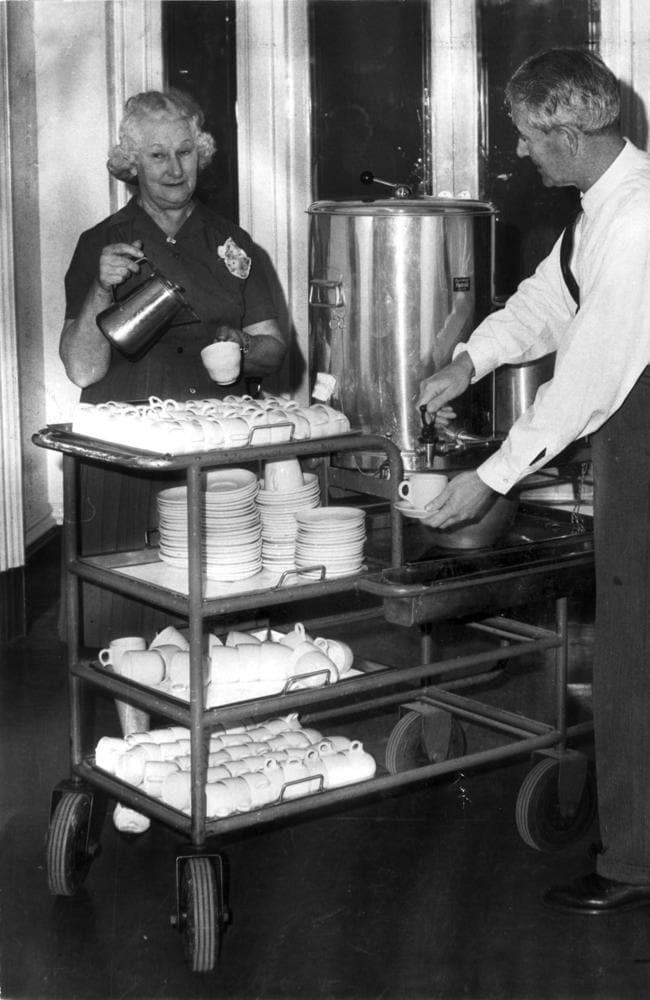 Eve Wilson serves tea in china cups from her trolley at the Melbourne Town Hall in 1967. Automatic dispensing machines — using polystyrene cups — replaced Eve and her colleagues. Picture: Herald Sun Image Library