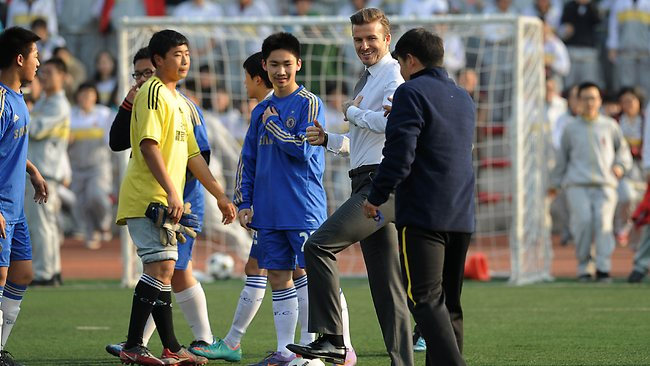 David Beckham plays soccer with students during a visit to a middle school in Beijing. He refused to rule out the possiblity that he would play in China after his contract with PSG ends. Picture: AFP PHOTO /WANG ZHAO