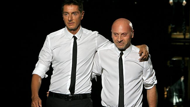 (FILES) Picture taken on June 23, 2007 shows Italian fashion designers Domenico Dolce (L) and Stefano Gabbana acknowledge the applause after presenting their Dolce & Gabbana 2008 spring/summer men's collection at Milan's fashion week. An Italian court on June 19, 2013 sentenced fashion house duo Dolce & Gabbana to one year and eight months in prison for tax evasion of around one billion euros ($1.33 billion), according to Italian media reports. AFP PHOTO/FILIPPO MONTEFORTE
