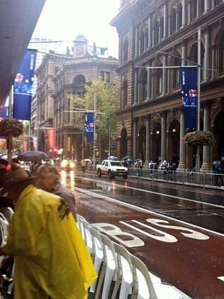 Rain sweeps George St in Sydney's CBD ahead of the march. Picture: @johannahartcher