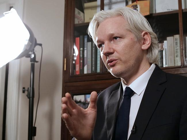 Julian Assange speaks to  <i>Meet The Press</i> and News Ltd journalist Charles Miranda inside the Ecuadorean embassy in London. Picture: Ella Pellegrini