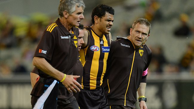 Cyril Rioli leaves the field after hurting his hamstring. Picture: Wayne Ludbey