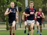 Co-captain Jack Trengove leads teammates in a run around Gosch's Paddock today. Picture: Klein Michael