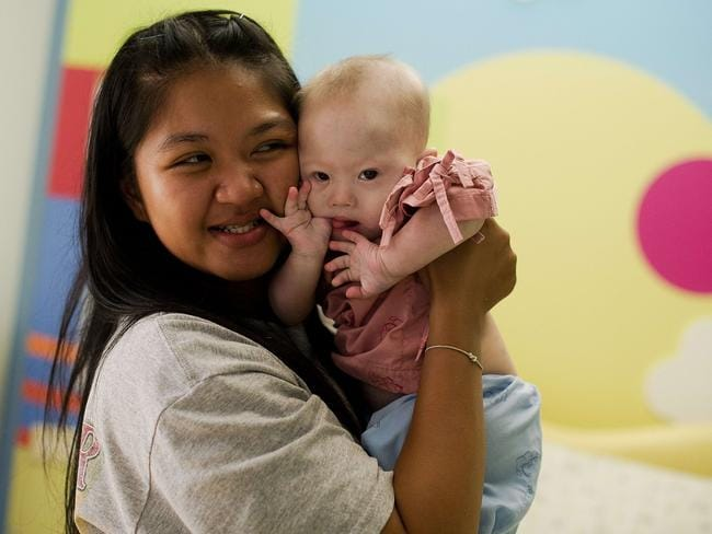 """I will not allow them to come to take my baby away"" ... Thai surrogate mother Pattaramon Chanbua holds Gammy. Picture: AFP"