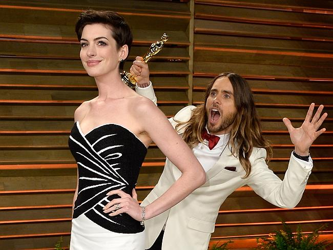 Anne Hathaway and Jared Leto attend the 2014 Vanity Fair Oscar Party.