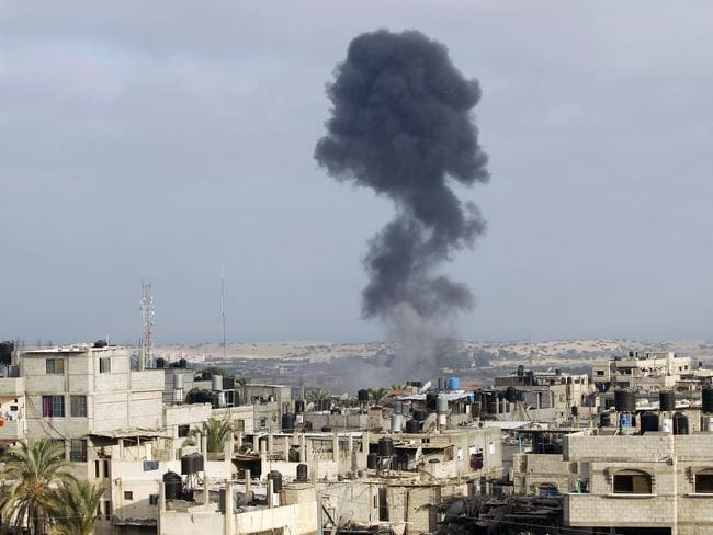 Sign of destruction ... smoke billows following an Israeli military strike east of Rafah. Picture: Said Khatib / AFP PHOTO