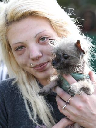 Cheyenne Dean with her pet chihuahua-cross Phoebe, which firefighters saved from the house. Picture: Stephen Laffer.