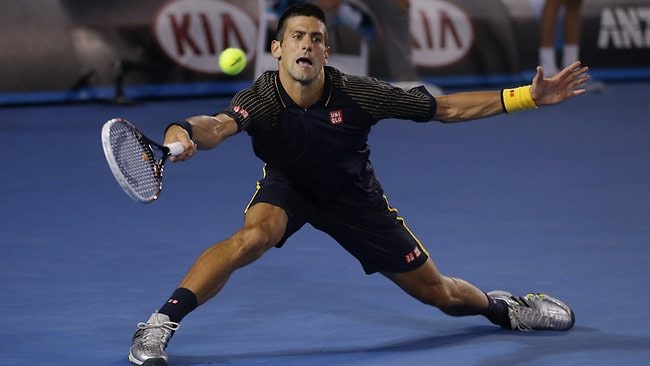 Serbia's Novak Djokovic hits a forehand return to Switzerland's Stanislas Wawrinka. Picture: Dita Alangkara