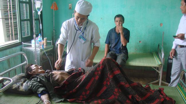 Ho Van Thanh is by a local doctor at a health centre in Quang Ngai province after being discovered in the jungle 40 years after he fled his home during a bombing raid during the Vietnam War. Picture: AAP