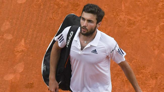 French's Gilles Simon leaves after his compare opposite Serbia's Novak Djokovic.