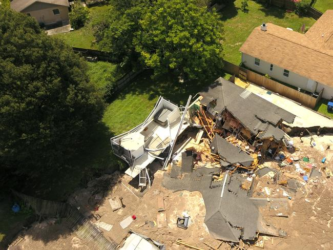In this aerial photo, debris is strewn about after the sinkhole's damage. Picture: Luis Santana/Tampa Bay Times via AP