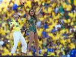 Singers Pitbull (L) and Jennifer Lopez perform during the Opening Ceremony of the 2014 FIFA World Cup Brazil prior to the Group A match between Brazil and Croatia at Arena de Sao Paulo on June 12, 2014 in Sao Paulo, Brazil. (Photo by Buda Mendes/Getty Images)