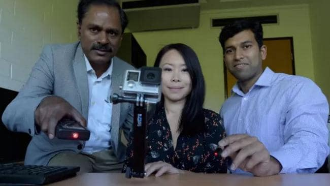 (From left) Professor Marimuthu Palaniswami, Associate Professor Elaine Wong and Dr Aravinda Sridhara Rao with a prototype of camera and lasers that will be developed into a final device. Picture: Paul Burston/University of Melbourne.