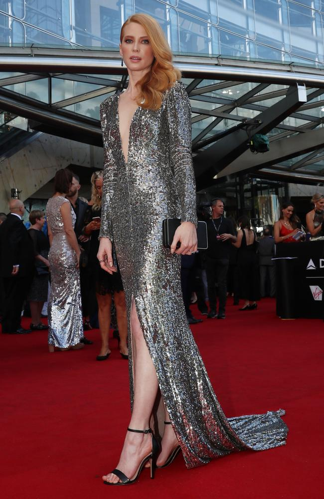 Best Lead Actress winner Emma Booth arrives. Booth's glittering AACTAs red carpet look was a long way from her turn as a serial killer in Hounds of Love. Picture: Cole Bennetts/Getty Images